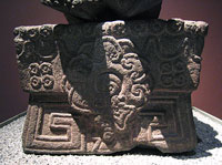 A large flower symbol stands out on the base of Xochipilli's statue, National Museum of Anthropology, Mexico City
