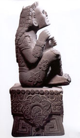 Pic 3: Sculpture of Xochipilli, adorned with flowers
