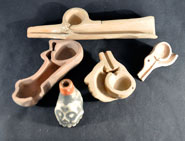 Pic 2: Models of the insides of Mesoamerican whistles and other simple flutes, showing the air duct in each