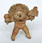 Pic 6: Figurine holding a rattle; the head is an actual whistle. Colima, late preclassic