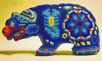 Pic 2: Huichol bead craft depicting a blue bear with scorpion and peyote imagery