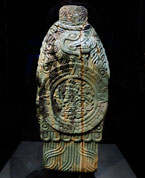 Pic 5: Rear view of the greenstone figure of a god, showing a solar disc with representation of the sun god Tonatiuh