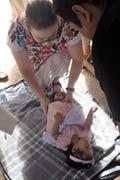 Pic 9: Author massaging her godchild
