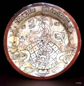 The Maya maize god, representing human beings, is born out of the turtle of the earth; he is aided by his two sons, the Hero Twins. Kerr database K1892