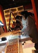 Pic 13: The original Tonalamatl de Aubin is prepared for exhibition in Mexico City in 2014