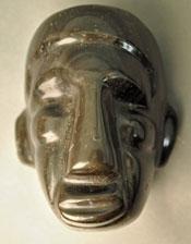 Stylised Aztec human head of obsidian