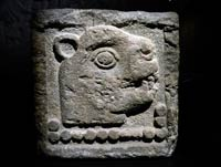 Aztec stone relief showing the date 13-Jaguar
